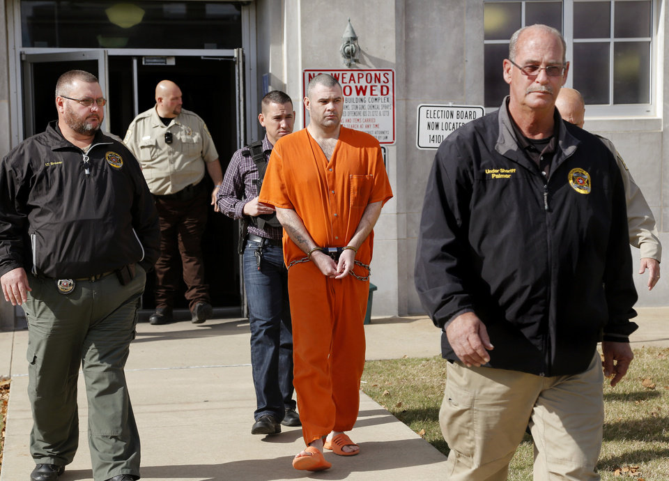 Photo - Byron James Shepard is taken from the courthouse under heavy guard and escorted to a prisoner transport van outside the Pottawatomie County Courthouse on Thursday, Nov. 9, 2017.   Shepard is accused of shooting and killing  Tecumseh police officer Justin Terney earlier this year. Photo by Jim Beckel, The Oklahoman