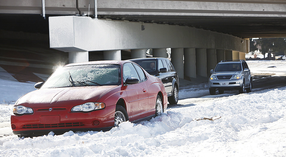 Photo - A car is stuck in the snow on Kelly just north of Memorial.