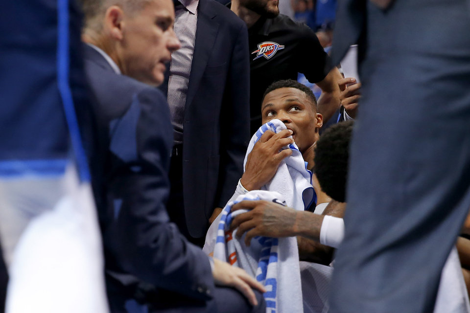 Photo - Oklahoma City's Russell Westbrook (0) sits on the bench during a timeout in an NBA basketball game between the Oklahoma City Thunder and the Sacramento Kings at Chesapeake Energy Arena in Oklahoma City, Sunday, Oct. 21, 2018. Photo by Bryan Terry, The Oklahoman
