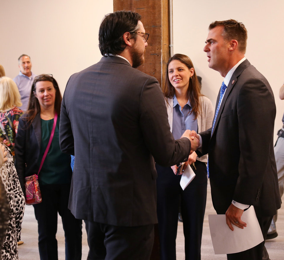 Photo - Gov. Kevin Stitt greets people before the ceremony during the Rural Sourcing ribbon cutting and open house Wednesday, May 1, 2019. [Doug Hoke/The Oklahoman]