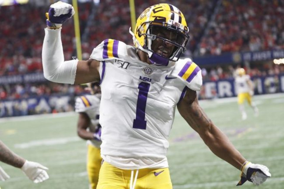 Photo -  LSU's Ja'Marr Chase celebrates his touchdown against Georgia during the first half of the SEC title game on Dec. 9. [AP Photo/John Bazemore]