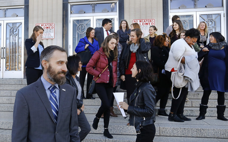 Photo -  Ryan Kiesel, executive director for American Civil Liberties Union of Oklahoma, is upbeat Tuesday, Dec. 12, 2017 as he and about two dozen supporters of Tondalao Hall's cause emerge from the Pottawatomie County Courthouse in Shawnee. [Jim Beckel/The Oklahoman file]
