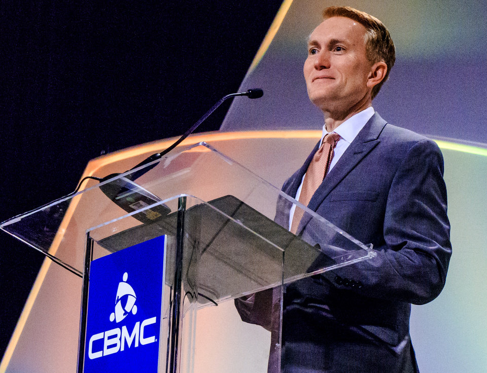 Photo - U.S. Senator James Lankford speaks to those gathered for the CBMC Metro Prayer Breakfast at the Cox Convention Center in Oklahoma City, Okla. on Tuesday, April 16, 2019.   Photo by Chris Landsberger, The Oklahoman
