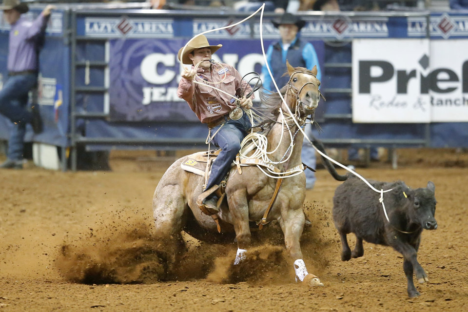 Photo - Clay Smith of Broken Bow, Okla., competes in the tie-down roping event during the Timed Event Championship inside the Lazy E Arena in Guthrie, Okla., Thursday, March 13, 2020. [Bryan Terry/The Oklahoman]