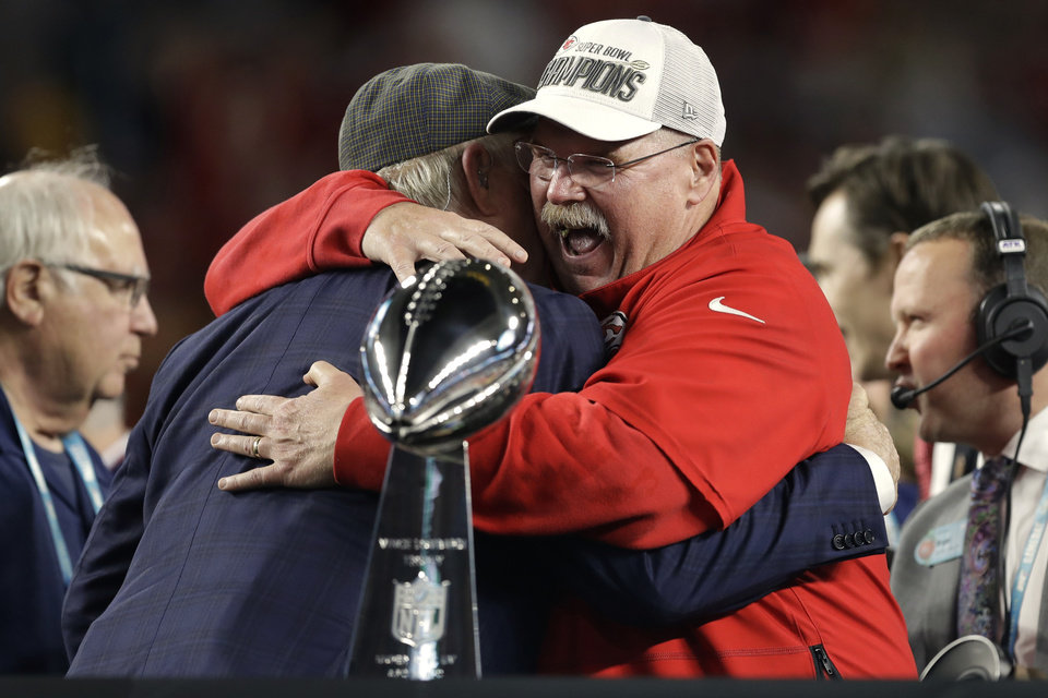 Photo - Kansas City Chiefs head coach Andy Reid receives congratulations from broadcaster Terry Bradshaw after defeating the San Francisco 49ers in the NFL Super Bowl 54 football game Sunday, Feb. 2, 2020, in Miami Gardens, Fla. (AP Photo/Chris O'Meara)