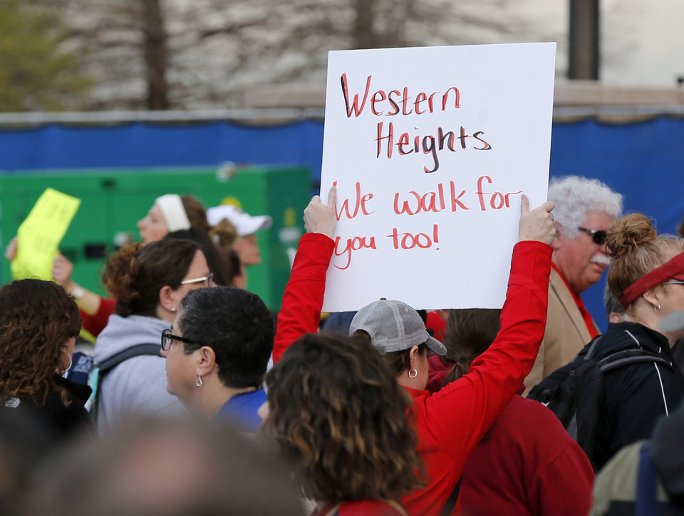 Photo - A person holds a sign supporting Western Heights Schools during the second day of a walkout by Oklahoma teachers at the state Capitol in Oklahoma City, Tuesday, April 3, 2018. Photo by Nate Billings, The Oklahoman