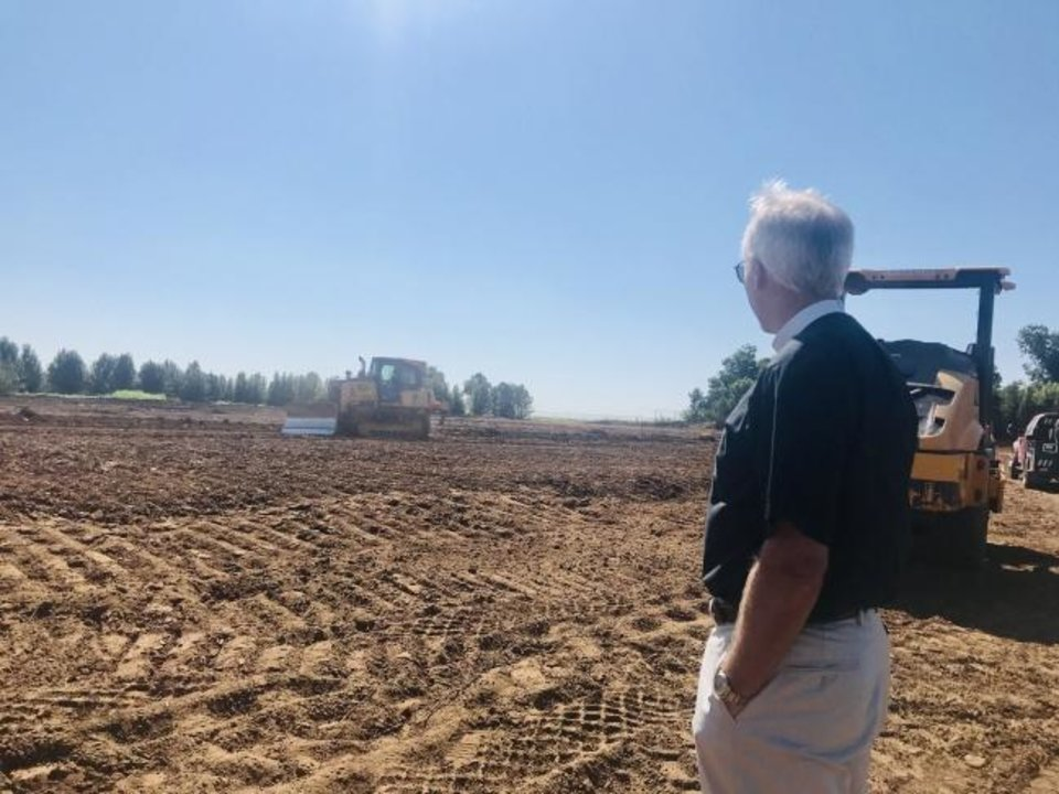 Photo -  The Rev. Mark Story, rector of St. Mary's Episcopal Church, looks out at the site of the church's new building north of the intersection of Covell Road and Broadway in Edmond. [Carla Hinton/The Oklahoman]