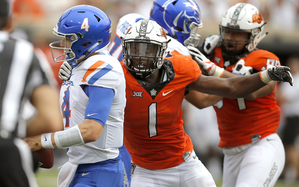 Photo - Oklahoma State's Calvin Bundage (1) puts pressure on Boise State's Brett Rypien (4) during a college football game between the Oklahoma State University Cowboys (OSU) and the Boise State Broncos at Boone Pickens Stadium in Stillwater, Okla., Saturday, Sept. 15, 2018. Oklahoma State won 44-21. Photo by Bryan Terry, The Oklahoman