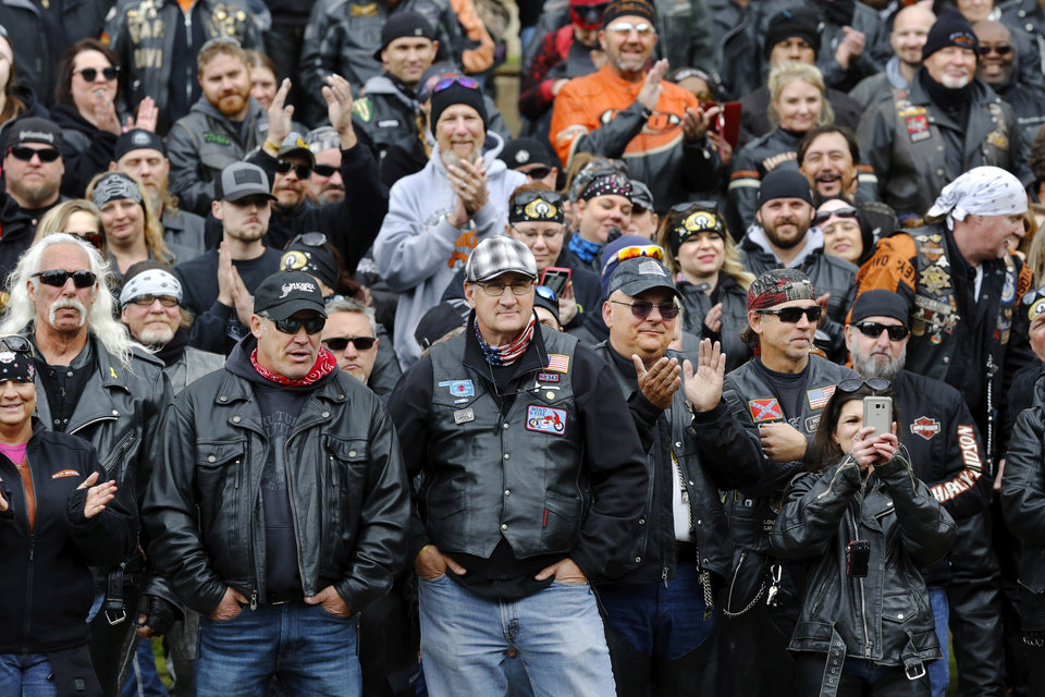 Photo - Oklahoma City Fire Chief Keith Bryant , front row, center, attended the event and stands with other bikers by the Reflecting Pool at the Oklahoma City National Memorial & Museum. Motorcyclists from across the country, numbering more than 1,000 strong, rumbled through the downtown streets of Oklahoma City on Saturday, April, 22, 2017,  taking part in  the 10th annual Ride to Remember.  The annual benefit run honors the 168 people killed in the April 19, 1995 bombing of the Alfred P. Murrah Federal Building. All funds raised go toward the Oklahoma City National Memorial and Museum, which operates solely on private donations. Bikers rolled out for the first event in 2007.    Photo by Jim Beckel, The Oklahoman