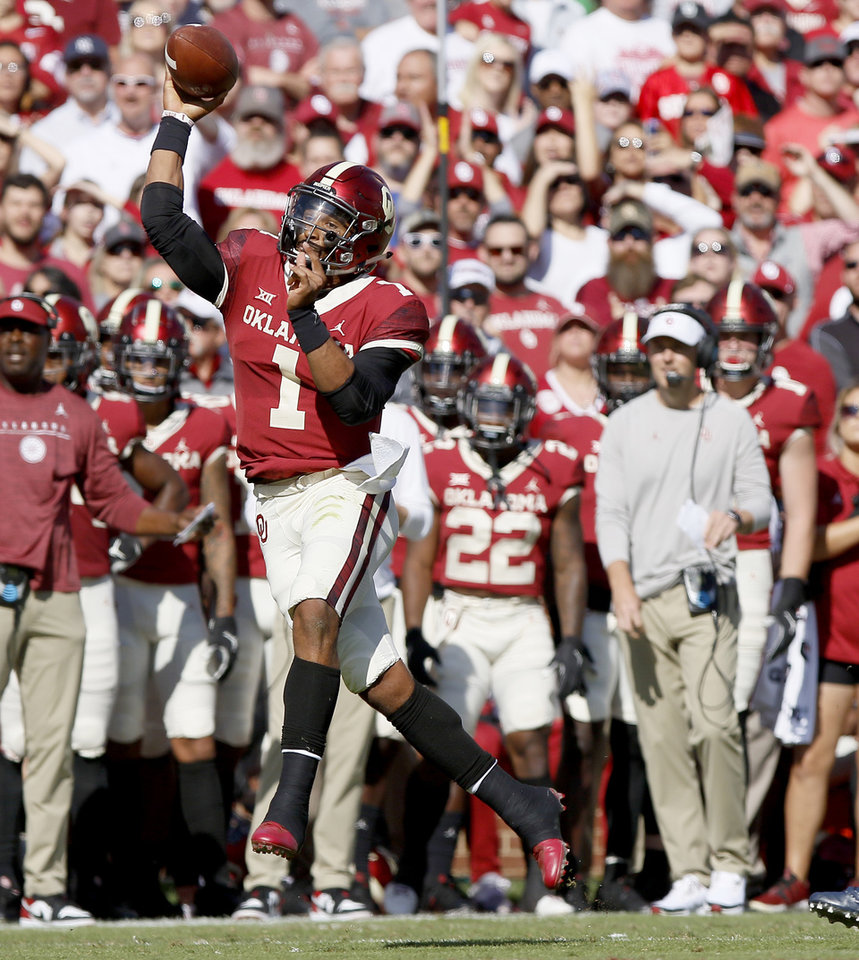 Photo - Oklahoma's Jalen Hurts (1) throws a pass during a college football game between the University of Oklahoma Sooners (OU) and the West Virginia Mountaineers at Gaylord Family-Oklahoma Memorial Stadium in Norman, Okla, Saturday, Oct. 19, 2019. Oklahoma won 52-14. [Bryan Terry/The Oklahoman]