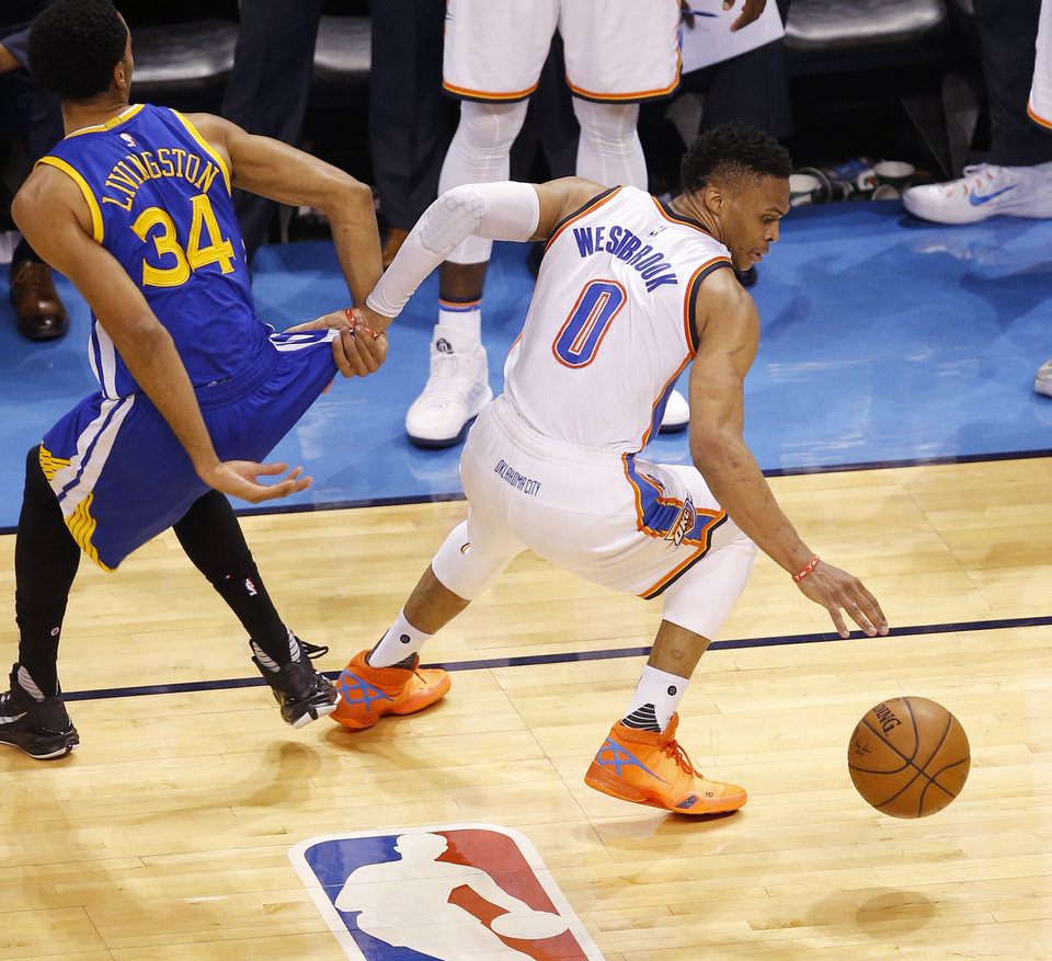 Photo - Oklahoma City's Russell Westbrook (0) steals the ball from Golden State's Shaun Livingston (34) during Game 6 of the Western Conference finals in the NBA playoffs between the Oklahoma City Thunder and the Golden State Warriors at Chesapeake Energy Arena in Oklahoma City, Saturday, May 28, 2016. Photo by Bryan Terry, The Oklahoman