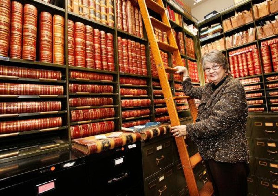 Photo - Frances Kersey, city clerk for Oklahoma City, inside the vault in the clerk's office at city hall.  The books at left are bound editions of the council journals. These date back to 1889. Photo by Jim Beckel, The Oklahoman ORG XMIT: KOD