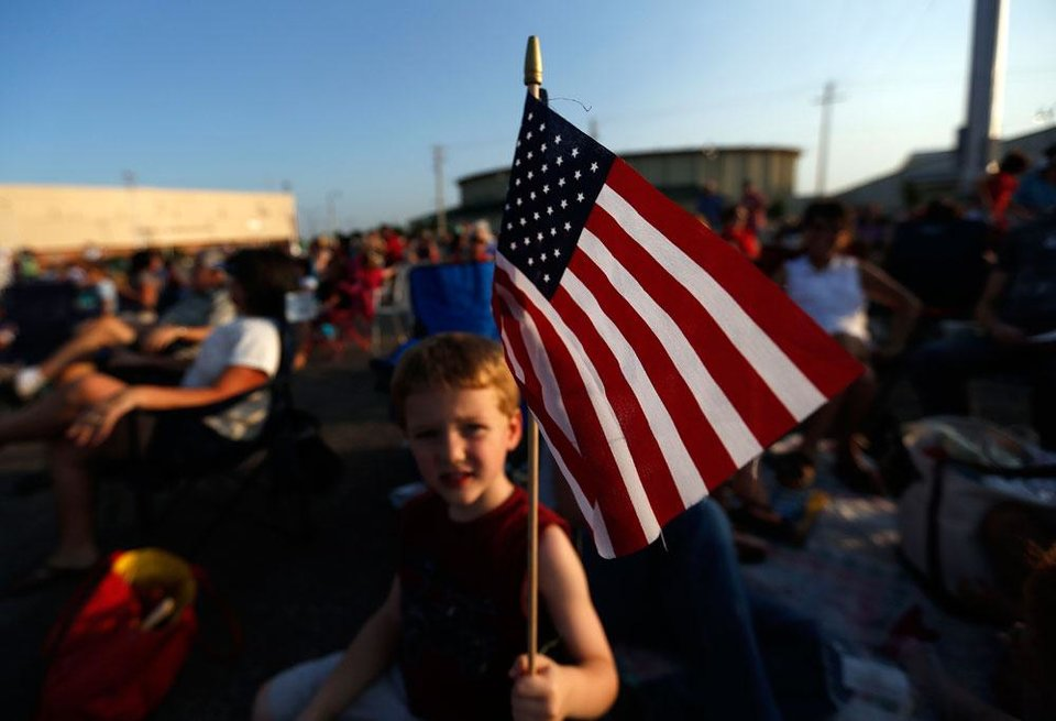 Photo -  Elliot Cockroft waves a flag during the Red, White and Boom at the State Fair Park in Oklahoma City, Tuesday, July 3, 2012. Photo by Sarah Phipps, The Oklahoman