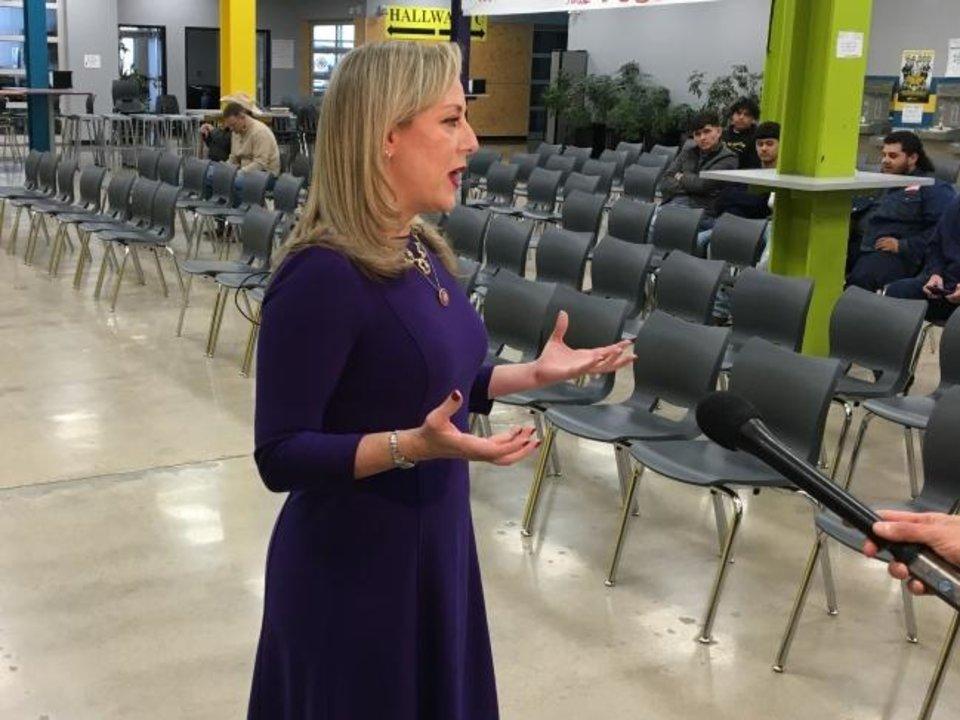 Photo -  U.S. Rep. Kendra Horn talks to reporters Sunday before a town hall meeting at Santa Fe South High School in Oklahoma City. [Chris Casteel/The Oklahoman]