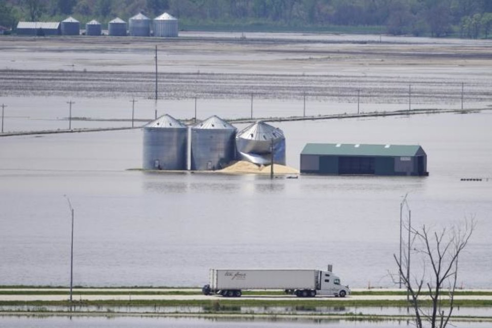 Photo -  Grain bins stand in floodwaters from the Missouri River, in Hamburg, Iowa. [AP PHOTO]