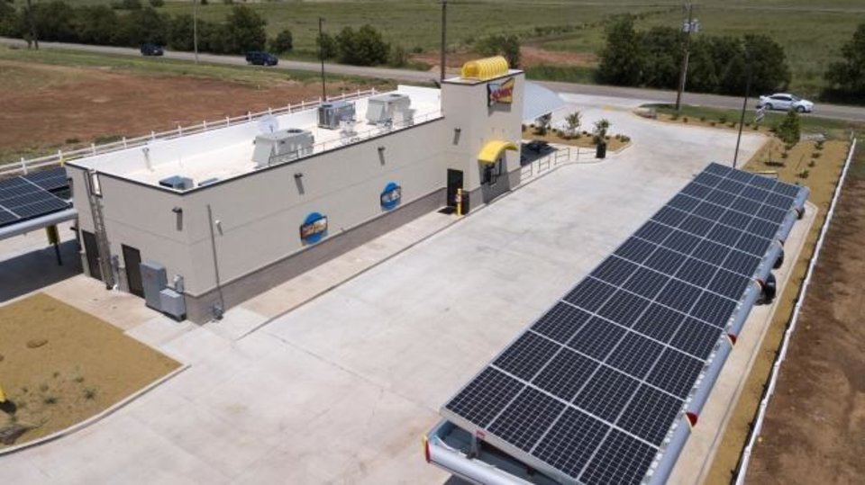 Photo -  As solar technology's capabilities have improved and costs have come down, more and more business owners like the one of this Sonic franchise on North Rockwell Avenue in Oklahoma City are using the systems to help control their energy costs. [DAVE MORRIS/THE OKLAHOMAN]