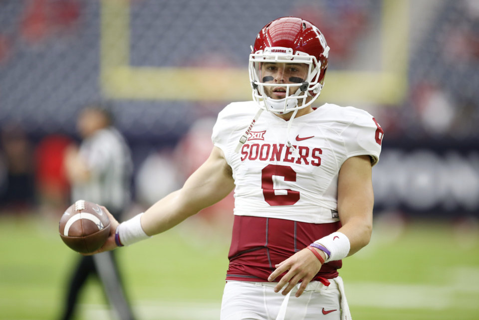 Photo - Oklahoma's Baker Mayfield (6) warms up before the AdvoCare Texas Kickoff college football game between the University of Oklahoma Sooners (OU) and the Houston Cougars at NRG Stadium in Houston, Saturday, Sept. 3, 2016. Photo by Bryan Terry, The Oklahoman