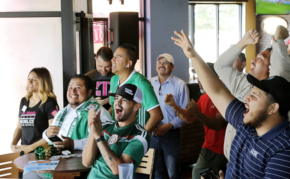 Photo -  Fans of the Mexico national soccer team react during a match with Sweden on Wednesday. [Photo by Jim Beckel, The Oklahoman]