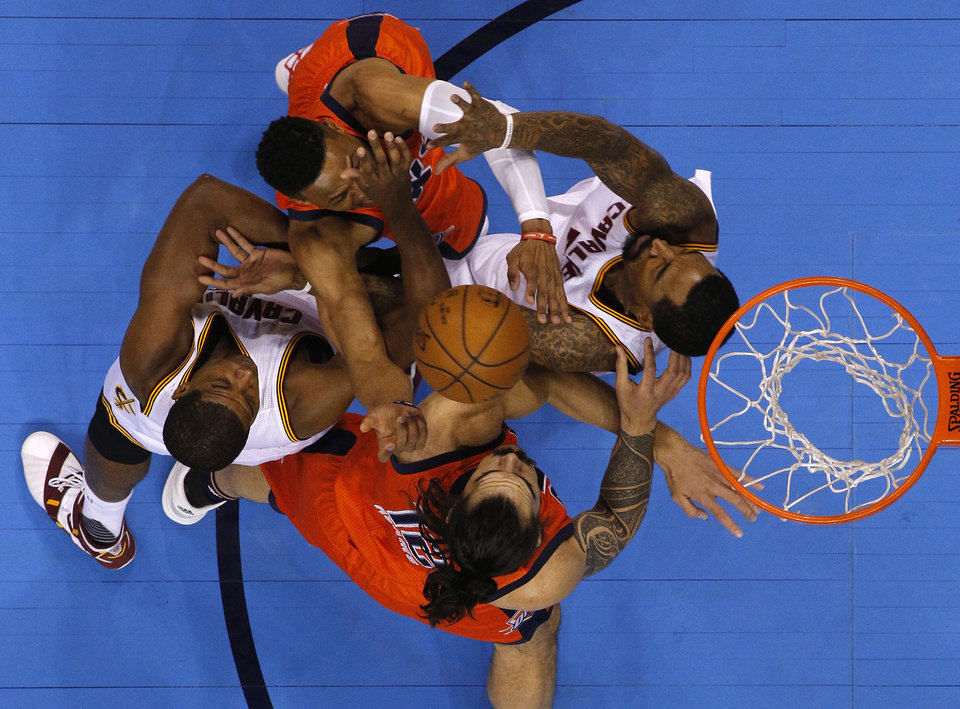 Photo - Oklahoma City's Russell Westbrook (0) gets caught between Cleveland's Tristan Thompson (13) and J.R. Smith (5) ash Oklahoma City's Steven Adams (12) during an NBA basketball game between the Oklahoma City Thunder and the Cleveland Cavaliers at Chesapeake Energy Arena in Oklahoma City, Sunday, Feb. 21, 2016. Oklahoma City lost 115-92.  Photo by Bryan Terry, The Oklahoman
