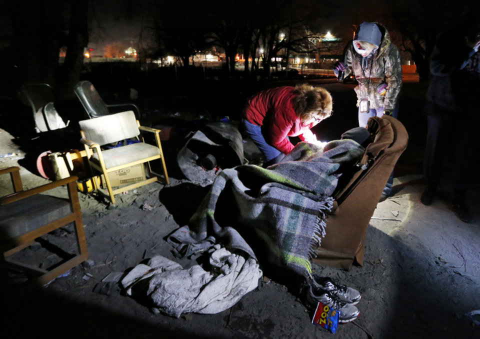 Photo - A homeless man is interviewed during Oklahoma City's annual Point-in-Time homeless count earlier this year. [The Oklahoman archives]