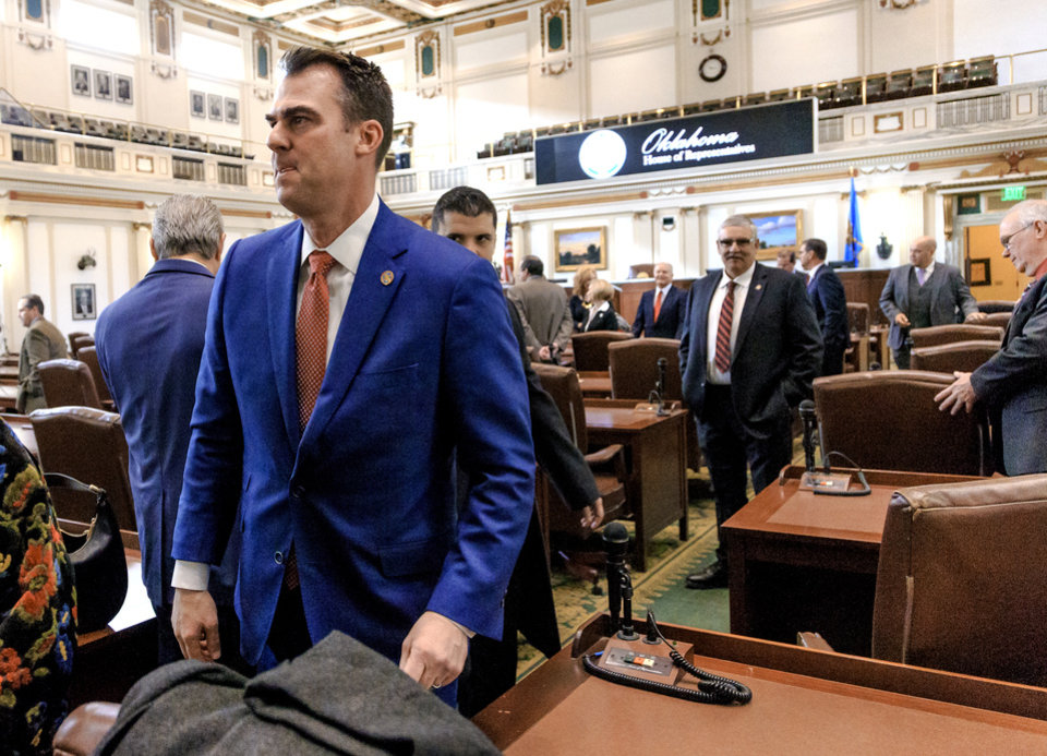 Photo - Gov. elect Kevin Stitt leaves the House floor after greeting representatives before his inauguration ceremony at the Oklahoma State Capitol in Oklahoma City, Okla. on Monday, Jan. 14, 2019.  Photo by Chris Landsberger, The Oklahoman