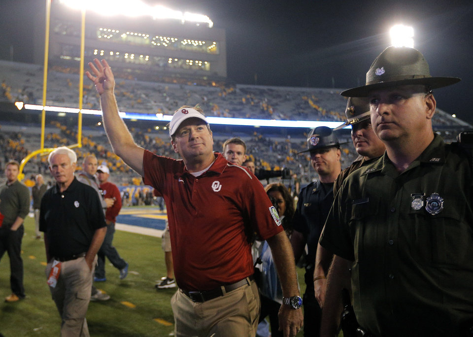 Photo - Oklahoma head coach Bob Stoops waves to fans following the college football game between West Virginia  Mountaineers and the University of Oklahoma Sooners at Milan Puskar Stadium in Morgantown, W.Va., Saturday, Sept. 20, 2014. Photo by Sarah Phipps, The Oklahoman