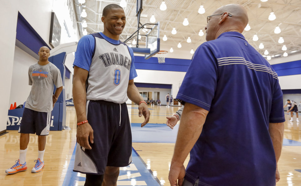 Photo - Russell Westbrook jokes around with Brian Davis during the Oklahoma City Thunder media availability at the Thunder practice facility in Oklahoma City, Okla. on Monday, May 12, 2014.   Photo by Chris Landsberger, The Oklahoman