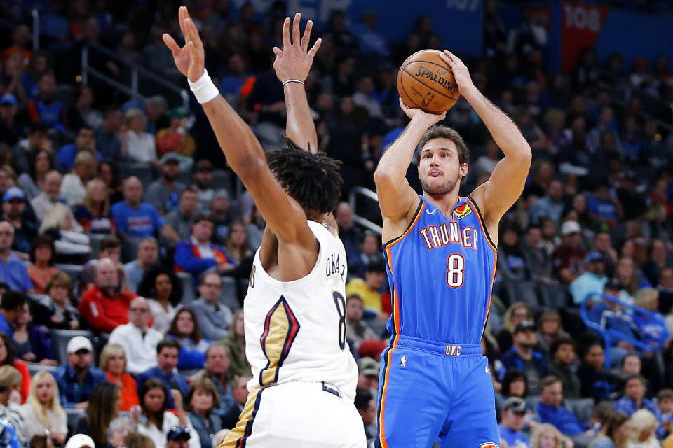 Photo - Oklahoma City's Danilo Gallinari (8) shoots  a basket over New Orleans' Jahlil Okafor (8) during an NBA basketball game between the Oklahoma City Thunder and the New Orleans Pelicans at Chesapeake Energy Arena in Oklahoma City, Saturday, Nov. 2, 2019. Oklahoma City won 115-104. [Bryan Terry/The Oklahoman]