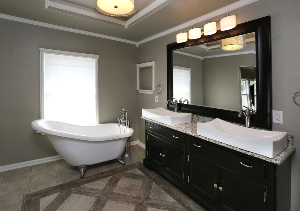 Luxury The master bath at NE features a classic tub and contemporary double lavatory PHOTO BY PAUL HELLSTERN THE OKLAHOMAN