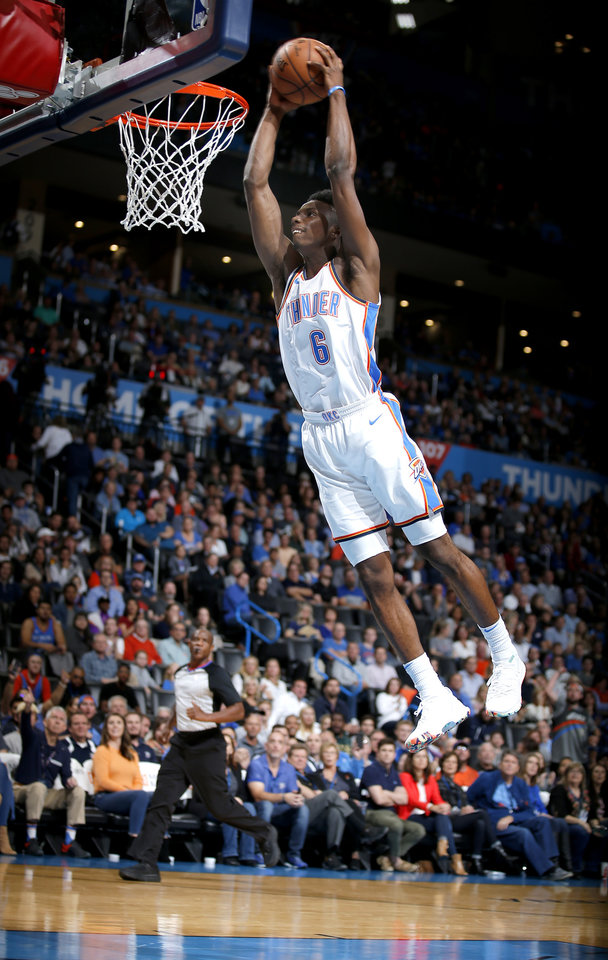 Photo - Oklahoma City's Hamidou Diallo (6) goes up for a dunk during the NBA game between the Oklahoma City Thunder and the LA Clippers at the Chesapeake Energy Arena, Tuesday, Oct. 30, 2018. OSU won 38-35. Photo by Sarah Phipps, The Oklahoman
