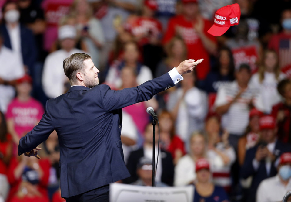 Photo - Eric Trump throws hats to the crowd before President Donald Trump speaks during a rally at the BOK Center in Tulsa, Okla., Saturday, June 20, 2020. [Sarah Phipps/The Oklahoman]