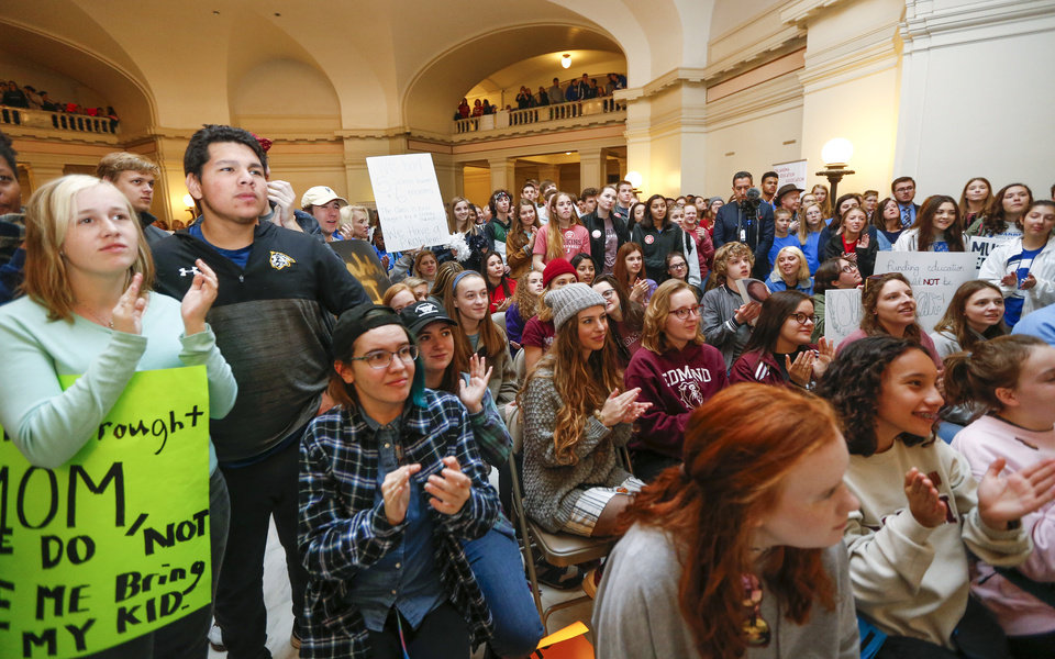 Photo - Students and supporters of increased education funding listen to a rally led by students on the second floor of the state Capitol during the eighth day of a walkout by Oklahoma teachers, in Oklahoma City, Monday, April 9, 2018. Photo by Nate Billings, The Oklahoman