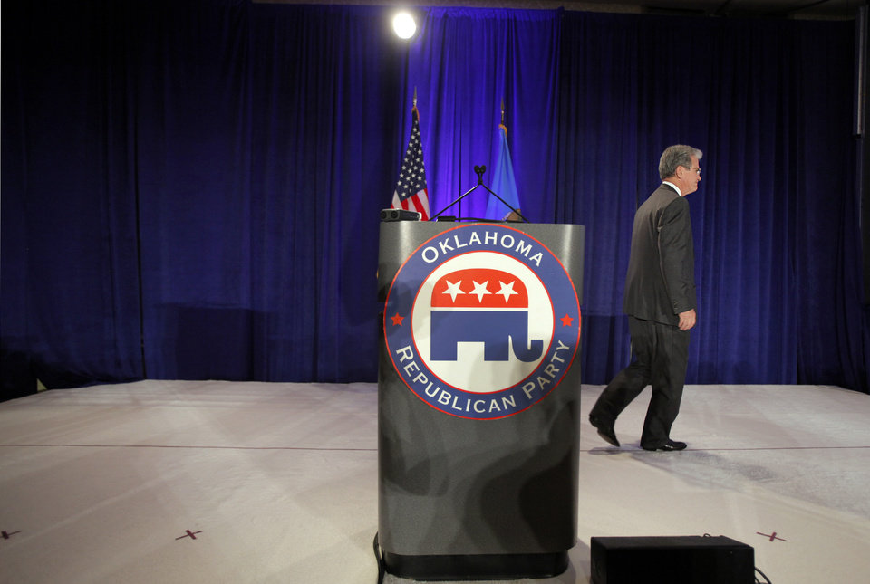Photo - U.S. Senator Tom Coburn walks off the stage after talking to supporters and thanking them for helping him to be elected to a second term at the republican Watch Party at the Marriott on Tuesday, Nov. 2, 2010, in Oklahoma City, Okla.   Photo by Chris Landsberger, The Oklahoman