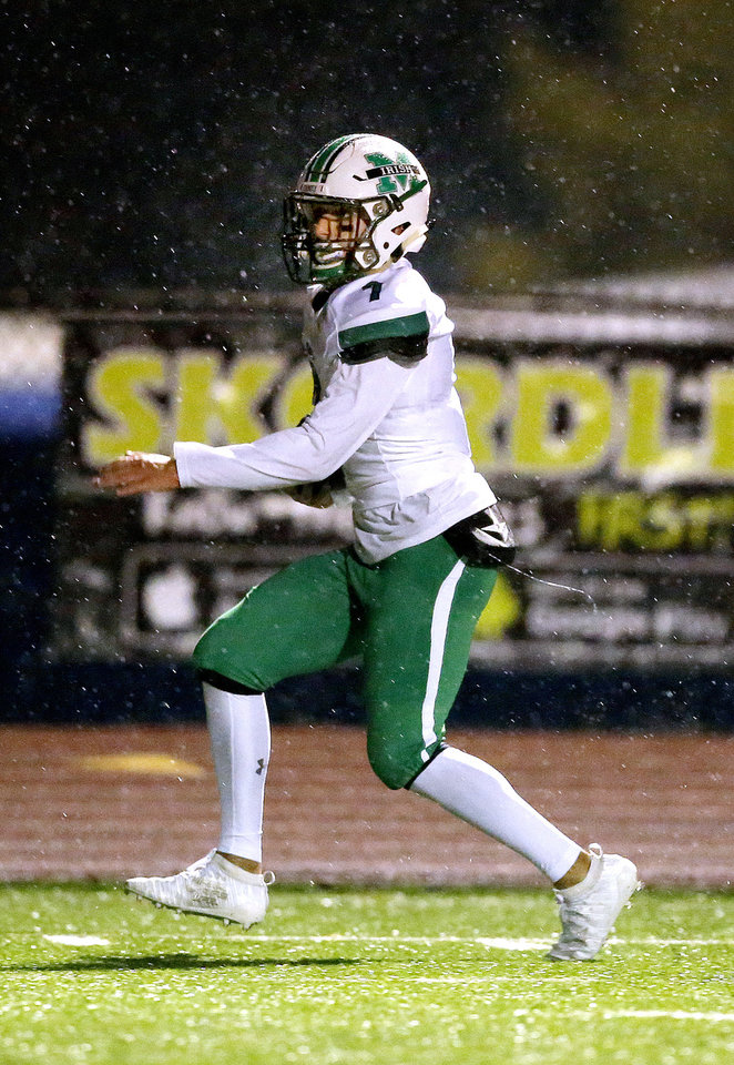 Photo - Bishop MCGuinness's Aaron Beck runs in for a touchdown during the high school football game between Piedmont and Bishop McGuinness at Piedmont High School in Piedmont, Okla.,  Friday, Oct. 25, 2019. [Sarah Phipps/The Oklahoman]