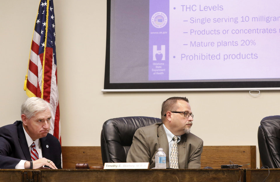 Photo - Tom Bates, left, and Timothy Starkey. Bates is interim commissioner for the Oklahoma Department of Health. Starkey is board president. The Oklahoma State Department of Health voted at their monthly meeting Tuesday morning, July 10, 2018, to ban sales of smokeable forms of medical marijuana and to require dispensaries to hire a pharmacist. The Board of Health voted on 75 pages of rules creating a rough framework for patients, physicians, caretakers and business owners interested in medical marijuana. The ban on sales of leaves and flowers for smoking and the requirement to hire a pharmacist weren't in the draft rules presented to the board, but were a priority of a coalition of medical groups. Julie Ezell, the Health Department's general counsel, presented the rules to a packed board room and to members of the public watching in an overflow room and online. She cautioned board members that the two new rules they added might not be allowed under the state question, inviting a court challenge. Photo by Jim Beckel, The Oklahoman