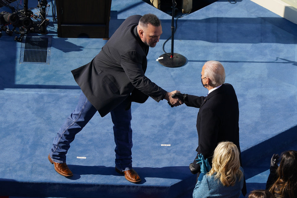 Photo - Country singer Garth Brooks shakes hands with President Joe Biden during the 59th Presidential Inauguration at the U.S. Capitol in Washington, Wednesday, Jan. 20, 2021. (AP Photo/Susan Walsh, Pool)