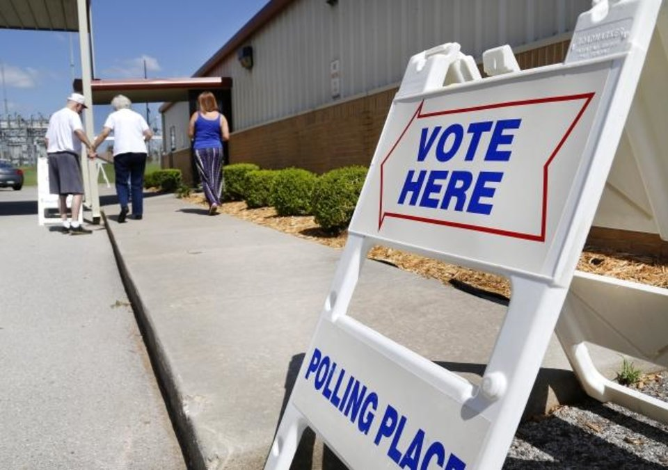 Photo -  Voters in precincts 97 and 98 shared voting booth space inside the Midwest City Community Church of the Nazarene near SE 15 and Post Rd during primary election voting on Tuesday, June 26, 2018.  An election worker at the site described voter turnout as