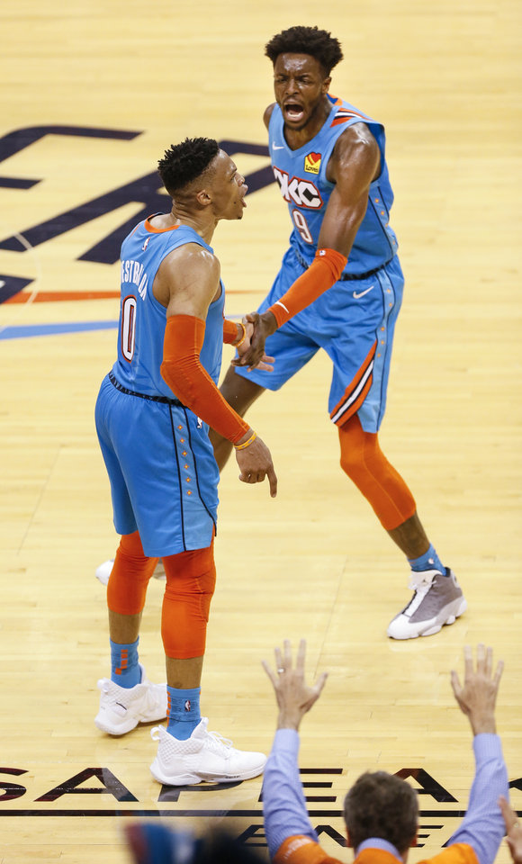Photo - Oklahoma City's Jerami Grant (9) celebrates with Oklahoma City's Russell Westbrook (0) as Westbrook yells after making a shot over Portland's Damian Lillard late in the fourth quarter during Game 3 in the first round of the NBA playoffs between the Portland Trail Blazers and the Oklahoma City Thunder at Chesapeake Energy Arena in Oklahoma City, Friday, April 19, 2019. Oklahoma City won 120-108. Photo by Nate Billings, The Oklahoman