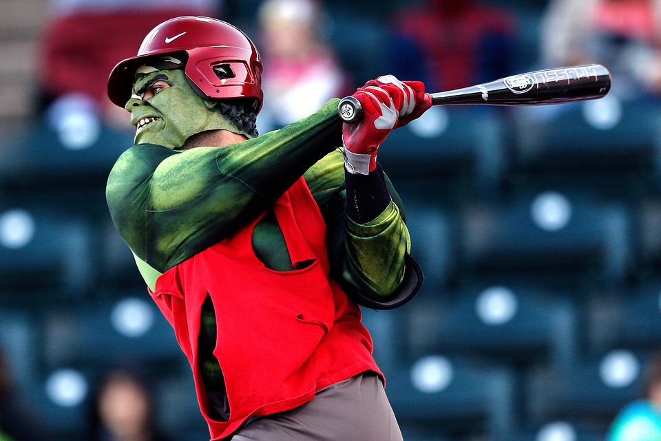 Photo -  Hulk, Anthony Hermelyn, swings during University of Oklahoma's baseball's  ALS Awareness Halloween Game at L. Dale Mitchell Park in Norman, Okla. , Thursday, Oct. 24, 2013. Photo by Sarah Phipps, The Oklahoman