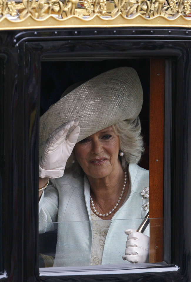 Camilla, Duchess of Cornwall, waves as she leaves Westminster Abbey at the  Royal Wedding in London Friday, April 29, 2011. (AP Photo/Alastair Grant)  ORG ...
