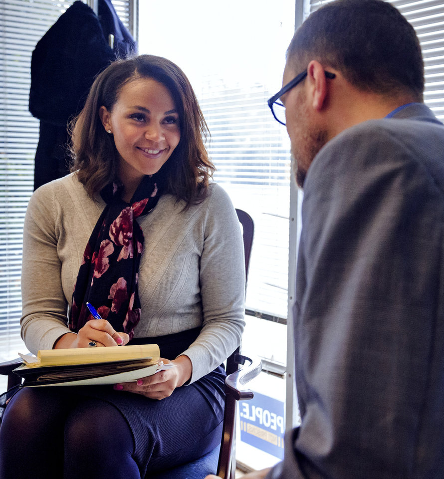 Photo -  Attorney Francie Ekwerekwu talks to one of her clients Luke Tribble in her office at  The Education and Employment Ministry, TEEM, where she is a staff member. [Chris Landsberger, The Oklahoman]