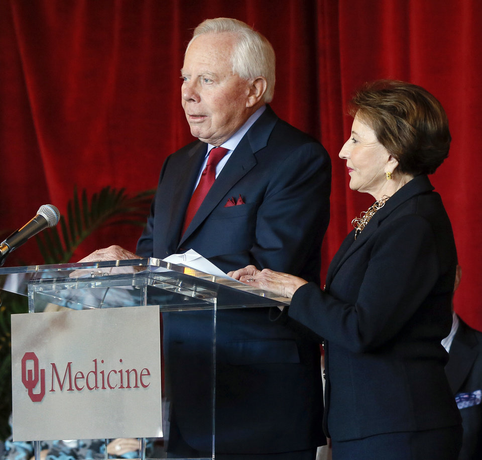 Photo - From left, Charles and Peggy Stephenson speak during the announcement of their $20 million gift to the Stephenson Cancer Center, 800 NE 10 St., in Oklahoma City, Friday, Nov. 15, 2019. [Nate Billings/The Oklahoman]