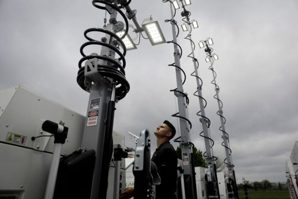 Photo -  Zeke Waite works on portable solar light towers Wednesday at Site Solar. Much of the company's business is with oil and gas companies, but Site Solar lighting towers can be seen in Tulsa at parking lots near the Gathering Place, the Tulsa Botanical Garden and during the annual Tulsa Tough cycling festival. [MIKE SIMONS/TULSA WORLD]