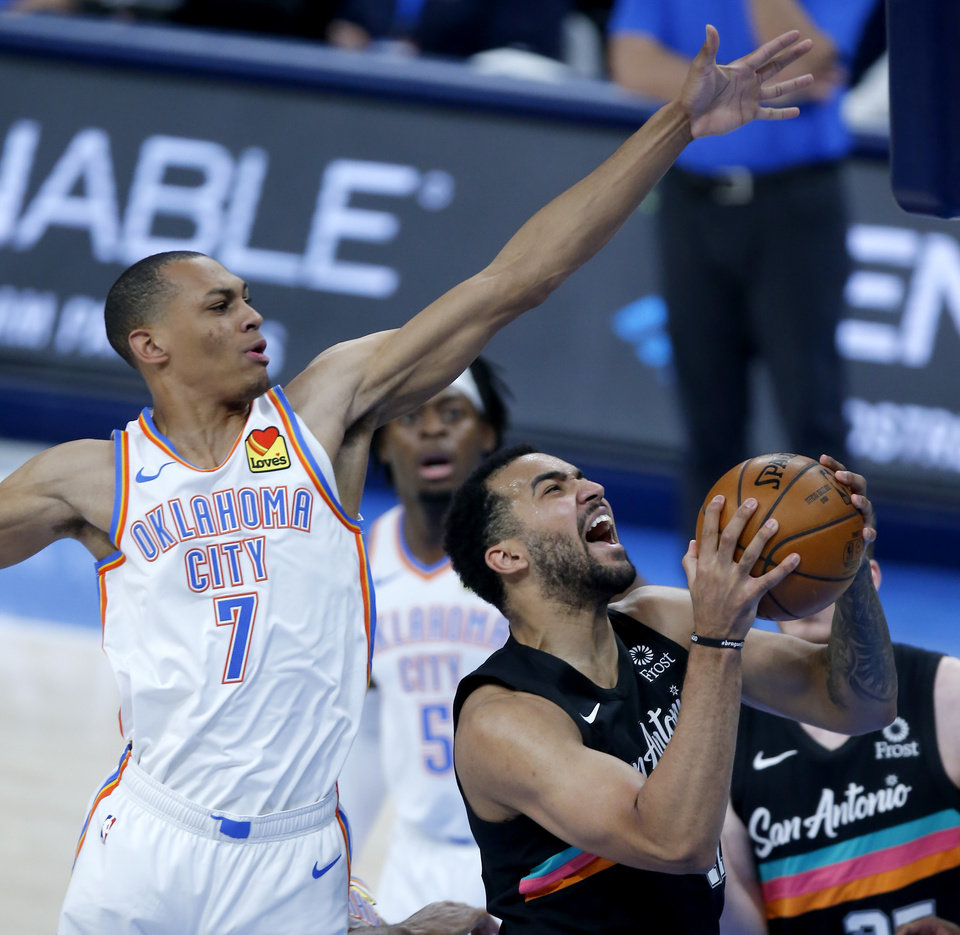 Photo - Oklahoma City's Darius Bazley (7) defends as San Antonio's Trey Lyles (41) goes up for a basket in the first quarter during the NBA basketball game between the Oklahoma City Thunder and the San San Antonio Spurs at the Chesapeake Energy Arena, Wednesday, Feb. 24, 2021. [Sarah Phipps/The Oklahoman]