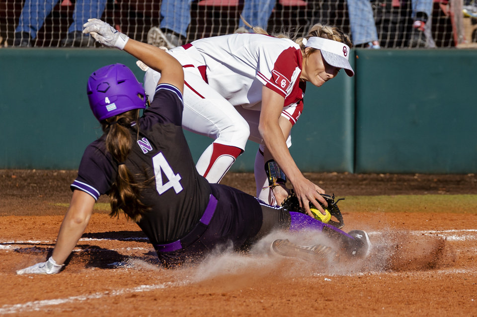 Photo - Oklahoma's Macy McAdoo (13) gets the out at home on Northwestern's Maeve Nelson (4) during the college softball game between the University of Oklahoma Sooners (OU) and Northwester University Wildcats (NU) at Marita Hynes Field in Norman, Okla. on Friday, Feb. 28, 2020.    [Chris Landsberger/The Oklahoman]