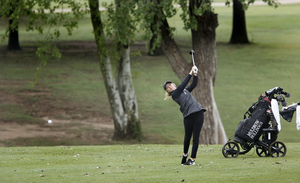 Photo - Muldrow High School junior Krislyn Andrews hits onto the fairway during Class 4A girls golf state tournament at Hefner South golf course on Wednesday, May 2, 2019.  [Jim Beckel/The Oklahoman]