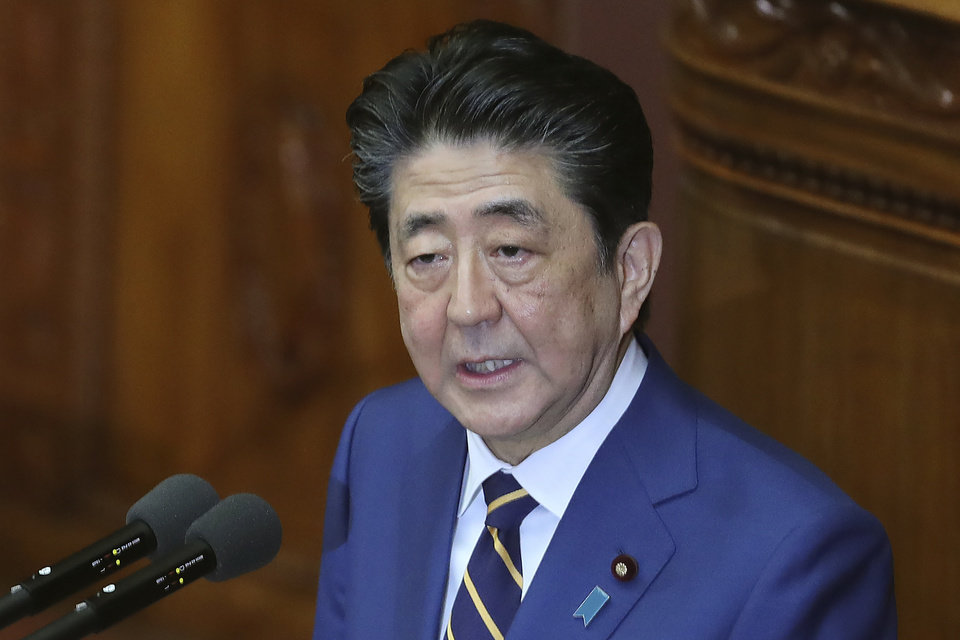 Photo -  Japanese Prime Minister Shinzo Abe delivers a policy speech in Tokyo on Monday. [Koji Sasahara/The Associated Press]