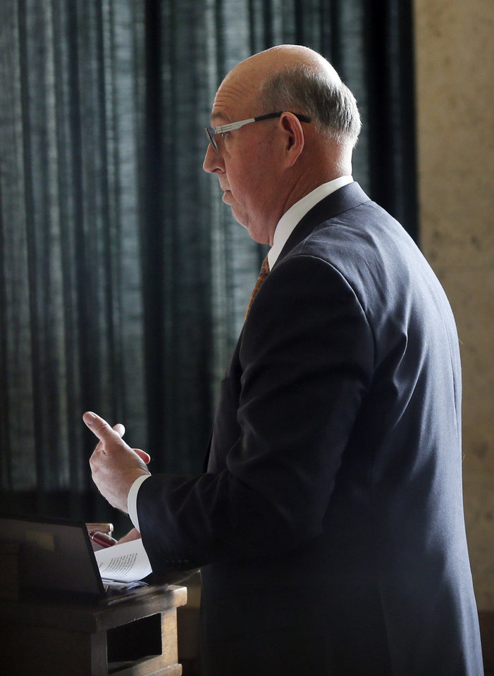 Photo - Andy Fugitt with the Center for Education Law speaks on behalf of Oklahoma City Public Schools during an injunction hearing on the Douglass-Locust Grove football controversy at the Oklahoma County Courthouse in Oklahoma City, Wednesday, Dec. 10, 2014. Photo by Nate Billings, The Oklahoman