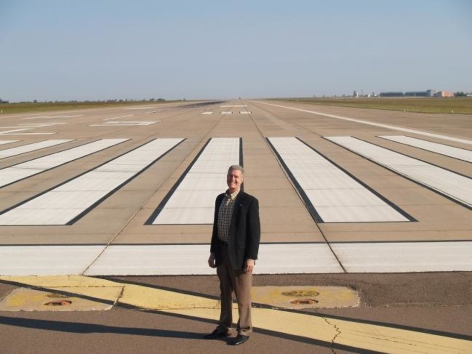 Photo -  Craig Smith, executive director of the Oklahoma Space Industry Development Authority, stands at the approach of one of OSIDA's key assets, a 2.5 mile-long runway in Burns Flat that makes up part of the Oklahoma Spaceport. Smith, who was hired this year, wants to focus the authority on the core business of developing Oklahoma's space industry. [ROD SERFOSS/CLINTON DAILY NEWS]