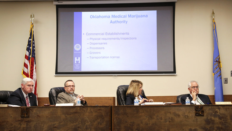 Photo - From left are Tom Bates. interim chairman for the Oklahoma Department of Health; Timothy Starkey, board president; Dr. Jenny Alexopulos, and Dr. Edward Legako, board vice-president. The Oklahoma State Department of Health voted at their monthly meeting Tuesday morning, July 10, 2018, to ban sales of smokeable forms of medical marijuana and to require dispensaries to hire a pharmacist. The Board of Health voted on 75 pages of rules creating a rough framework for patients, physicians, caretakers and business owners interested in medical marijuana. The ban on sales of leaves and flowers for smoking and the requirement to hire a pharmacist weren't in the draft rules presented to the board, but were a priority of a coalition of medical groups. Julie Ezell, the Health Department's general counsel, presented the rules to a packed board room and to members of the public watching in an overflow room and online. She cautioned board members that the two new rules they added might not be allowed under the state question, inviting a court challenge. Photo by Jim Beckel, The Oklahoman